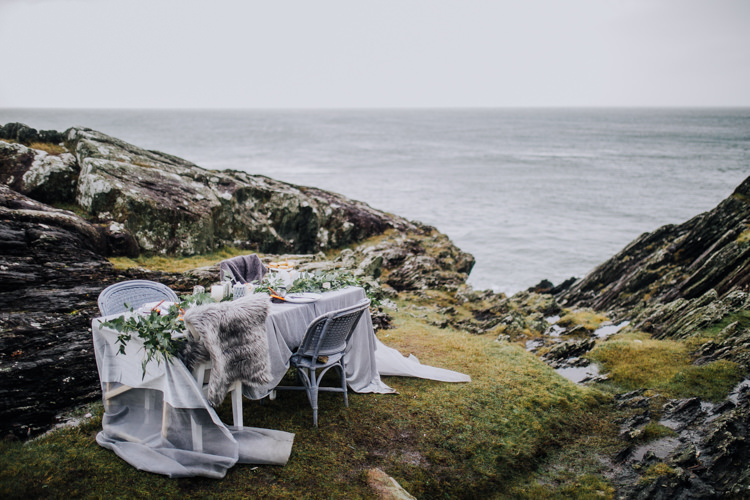Tablescape Decor Grey White Greeenery Candles Foliage Fabric Ocean Clifftop Elopement Wedding Ideas North Wales https://www.claracooperphotography.com/