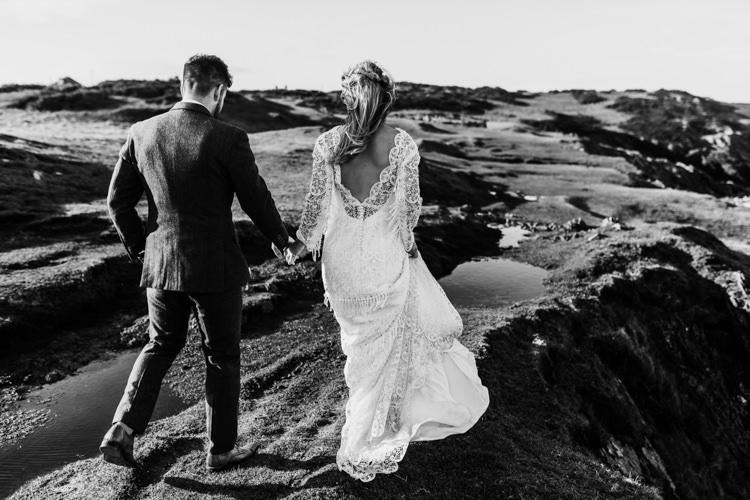 Dress Lace Sleeves Bride Bridal Hair Long Fringe Tassel Ocean Clifftop Elopement Wedding Ideas North Wales https://www.claracooperphotography.com/