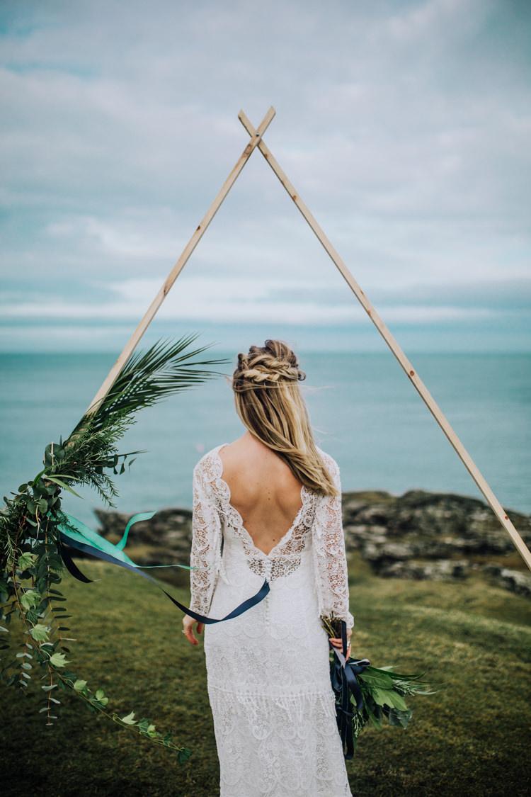 Dress Lace Sleeves Bride Bridal Hair Long Ocean Clifftop Elopement Wedding Ideas North Wales https://www.claracooperphotography.com/