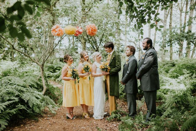 Field Outdoor Garden Tipi Hippie Bride Groom Bridesmaids Groomsmen Paper Pompoms Flower Arch | Happy Outdoor Forest Mustard Yellow Wedding http://suzi-photography.com/