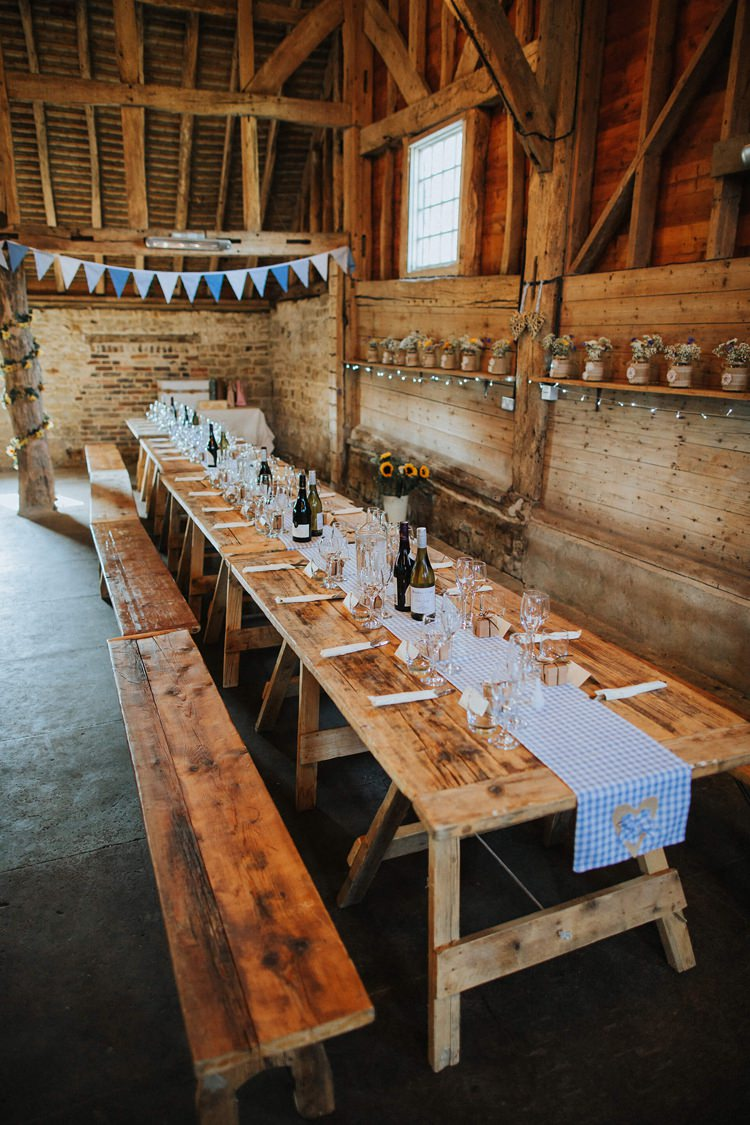Long Wooden Tables Bunting Rustic Homespun Country Chapel Barn Wedding Sussex http://www.olegssamsonovsphotography.com/
