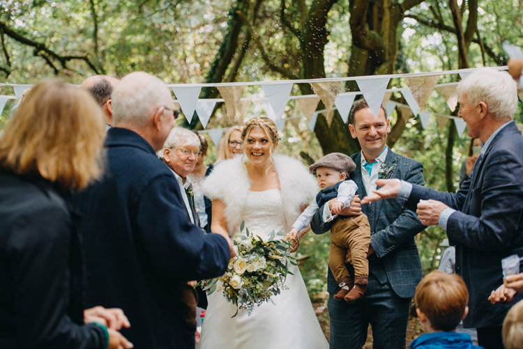 Bride Bridal Gown Dress Bolero Strapless Halo Braid Hairstyle Blue Checked Groom Cravat Three Piece Waistcoat Bouquet Bunting Magical Woodland Family Wedding http://photographybyclare.co.uk/