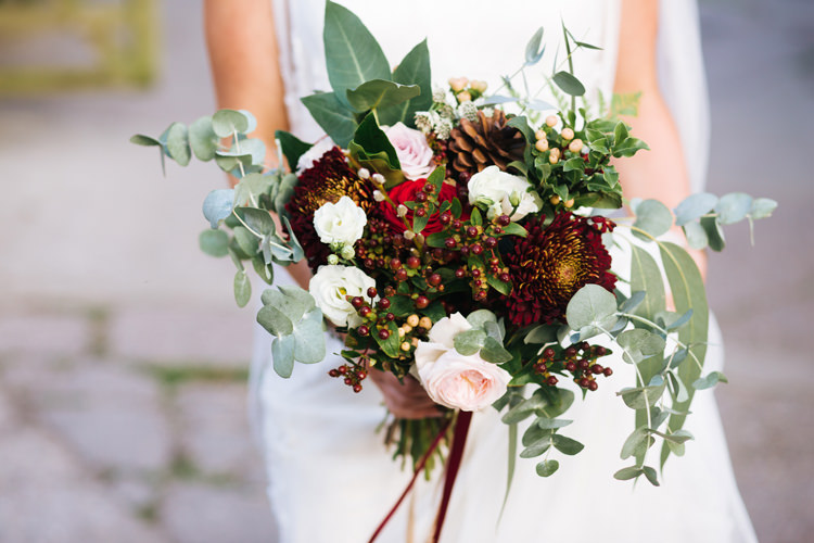 Bouquet Flowers Bride Bridal Rose Pinecone Berries Autumn Packington Moor Wedding Staffordshire Farm Barn Burgundy http://kathrynedwardsphotography.com/