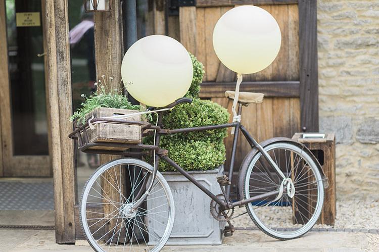 Bicycle Ballons Decor Darling Fresh Bohemian Barn Wedding https://razia.photography/