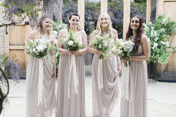 Bridesmaid Dresses Bouquets Ribbons Darling Fresh Bohemian Barn Wedding https://razia.photography/