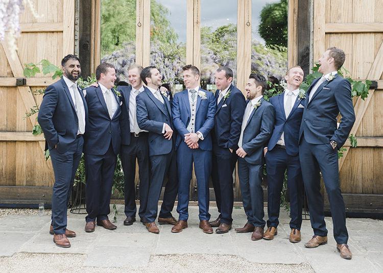 Groom Groomsmen Navy Suits Tan Darling Fresh Bohemian Barn Wedding https://razia.photography/