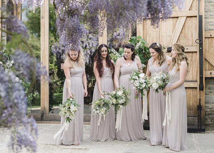 Bridesmaid Dresses Bouquets Ribbon Darling Fresh Bohemian Barn Wedding https://razia.photography/