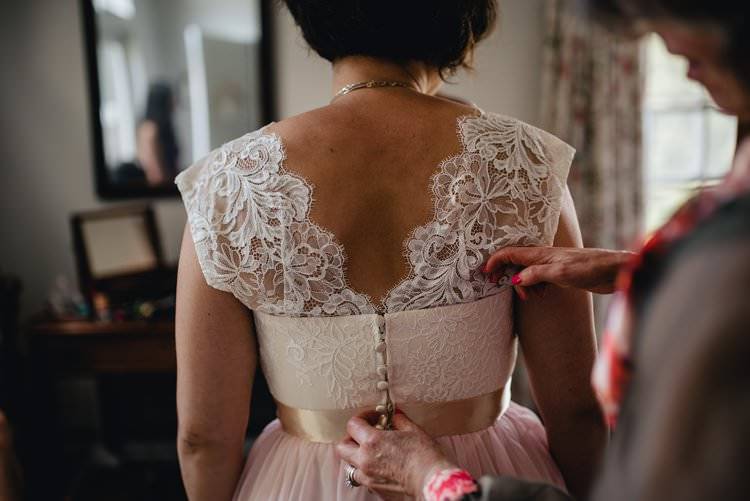 Outdoor Field Forest Wild Nature Floral Arch Marquee Tipi Bride Dress Lace Buttons Mother Prep | Breathtaking Secluded Back Garden Open Sided Tent Wedding Vermont https://kickasscouples.com/