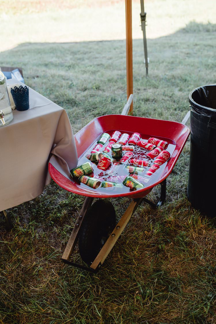 Outdoor Field Forest Wild Nature Marquee Tipi Wheelbarrow Cans Beers Drinks Rustic | Breathtaking Secluded Back Garden Open Sided Tent Wedding Vermont https://kickasscouples.com/