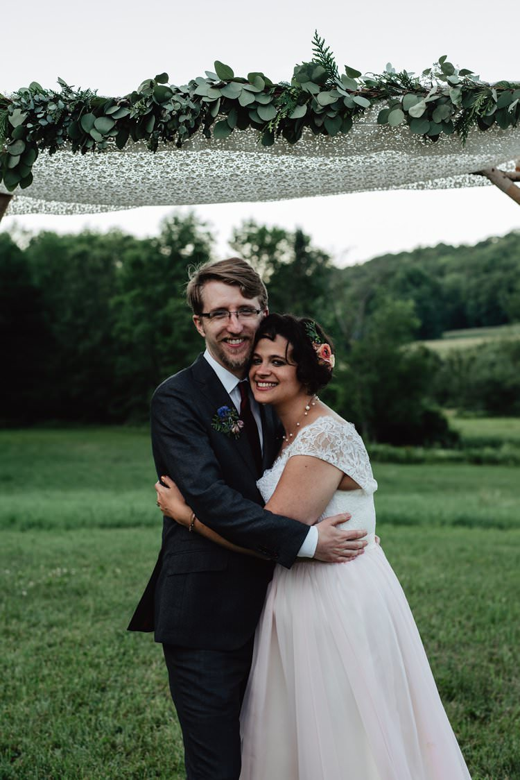 Outdoor Field Forest Wild Nature Marquee Tipi Floral Arch Bride Groom Embrace| Breathtaking Secluded Back Garden Open Sided Tent Wedding Vermont https://kickasscouples.com/