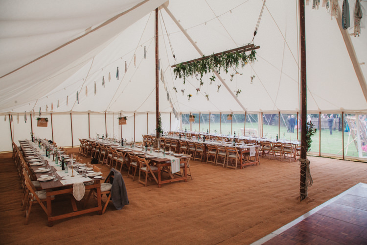 Marquee Rustic Tables Chairs Hanging Flowers Rag Bunting Natural Country Garden Hand Crafted Wedding https://emilytylerphotography.com/