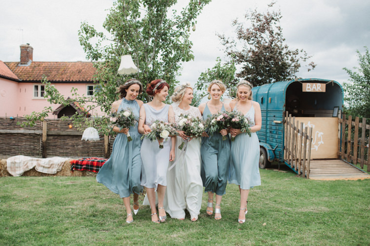 Blue Grey Mismatched Bridesmaid Dresses Bouquets Greenery Foliage Ribbon Flower Crowns Natural Country Garden Hand Crafted Wedding https://emilytylerphotography.com/