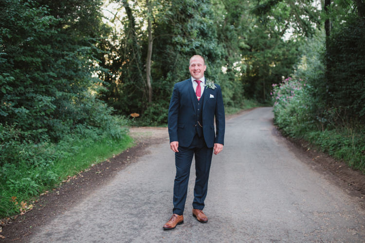 Navy Suit Red Tie Groom Natural Country Garden Hand Crafted Wedding https://emilytylerphotography.com/