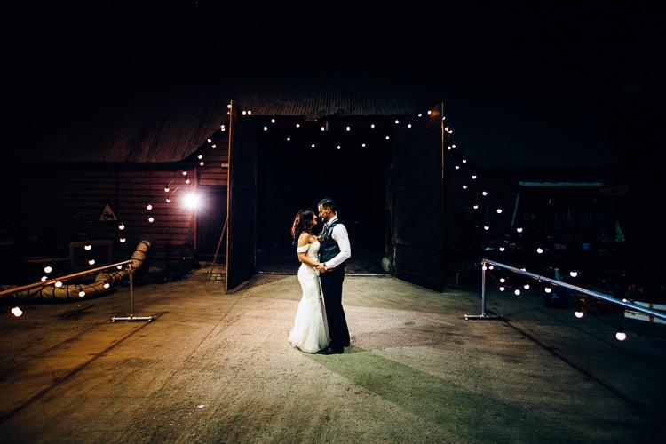 First Dance Edgy Raw Industrial Barn Wedding Ideas Greenery Festoon Lights http://www.two-d.co.uk/