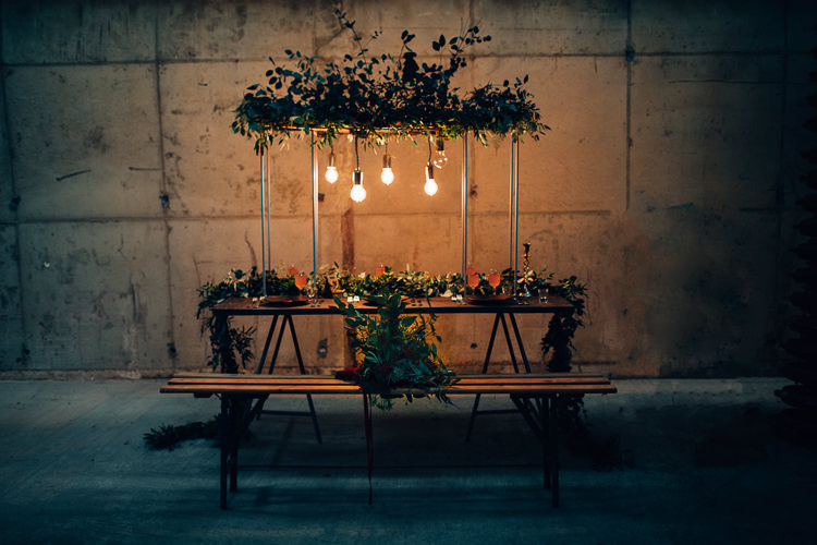 Table Tablescape Flowers Black Plates Calligraphy Swag Garland Suspended Edgy Raw Industrial Barn Wedding Ideas Greenery Festoon Lights http://www.two-d.co.uk/