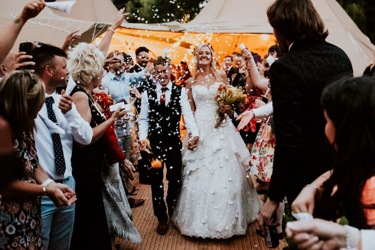 Bride Bridal Sweetheart Neckline Lace A Line Shoulder Jewellery Pearls Floral Flower Hairband Meadow Wildflower Corn Bouquet Groom Waistcoat Red Tie Confetti Shot Practically Perfect Tipi Camp Wedding Thwaite Mills https://photo.shuttergoclick.com/index