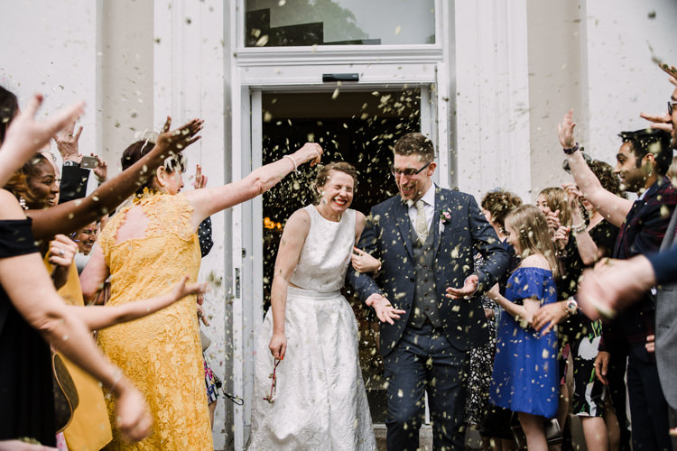 Bride Bridal Dress Gown Two Piece Crop Top Groom Grey Blue Green Three Piece Waistcoat Confetti Shot Fun DIY Wedding New Walk Museum Leicester https://www.daniellefrancescaphotography.com/