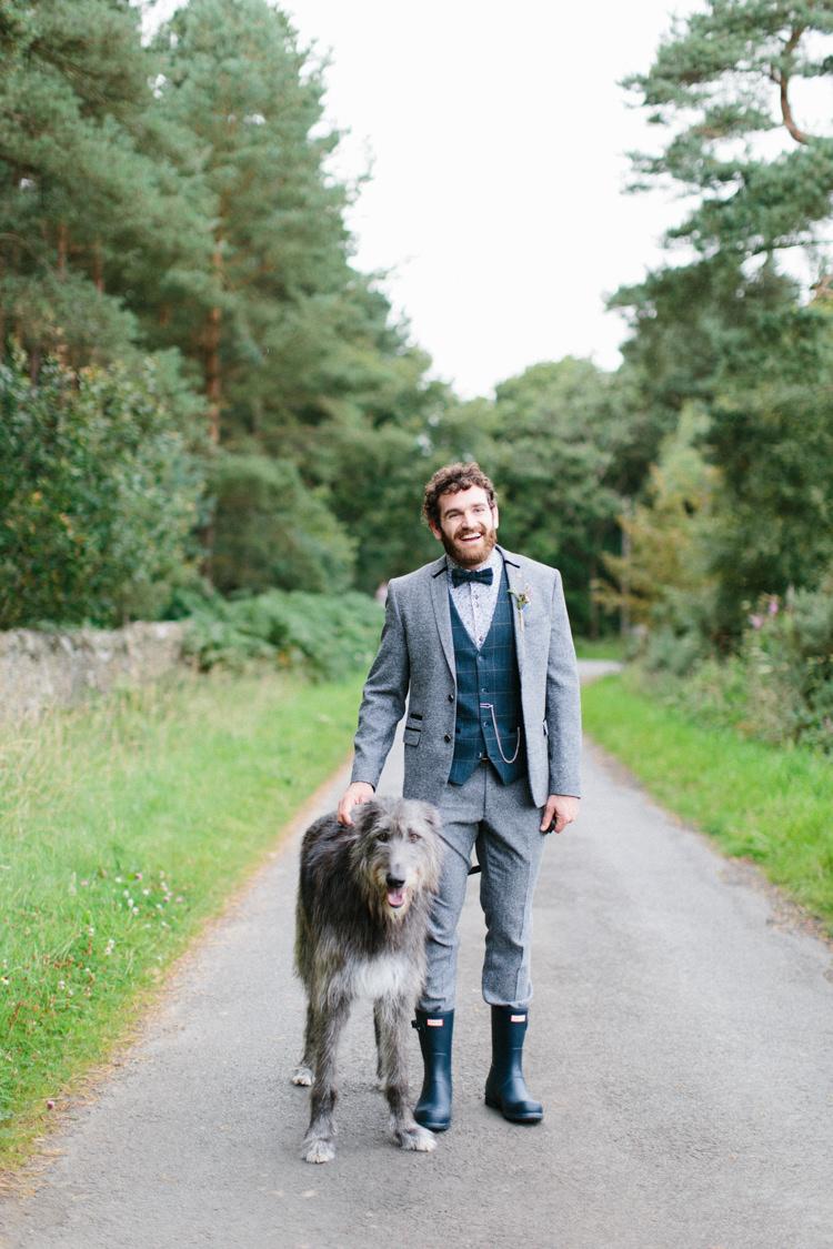 Groom Suit GRey Tweed Waistcoat Floral Shirt Bow Tie Hunter Wellies Dog Fun Joyful Pink Blue Summer Healey Barn Wedding Northumberland http://www.melissabeattie.com/