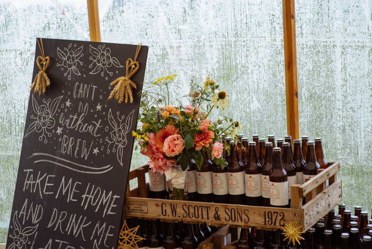 DIY Marquee Tipi Beer Bottle Wildflower Decor Alternative Hippy Forest Farm Field Garden Wedding | Homegrown Community Eclectic Rural Yorkshire Wedding https://toastofleeds.co.uk/