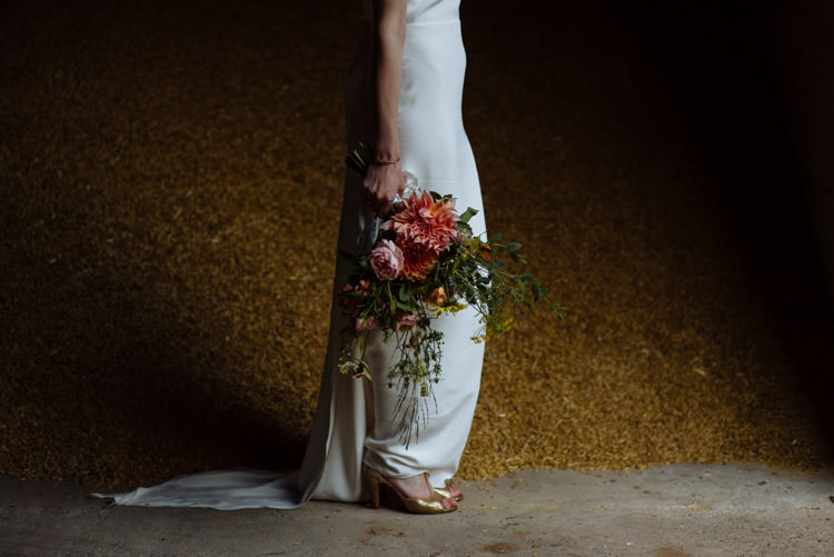 DIY Bride Gold Shoes Wildflower Bouquet Yellow Orange Pink Alternative Hippy Forest Farm Field Garden Wedding | Homegrown Community Eclectic Rural Yorkshire Wedding https://toastofleeds.co.uk/