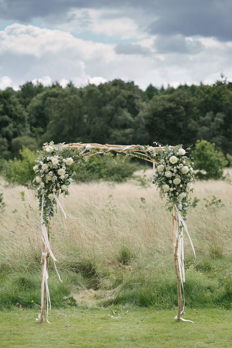 Ceremony Arch Greenery White Cream Flowers Floral Wood Relaxed Bohemian Summer Meadow Wedding https://karibellamy.com/