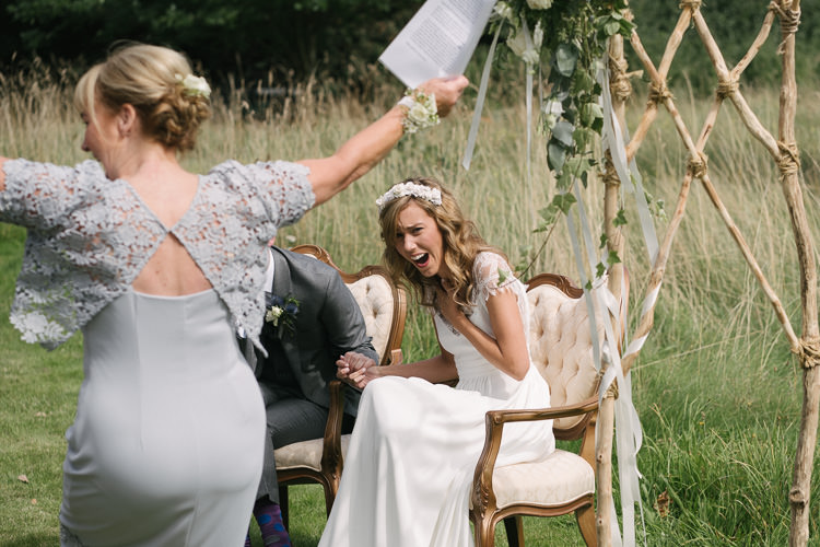 Ceremony Outdoor Seating Vintage Wooden Arch Arbour Relaxed Bohemian Summer Meadow Wedding https://karibellamy.com/