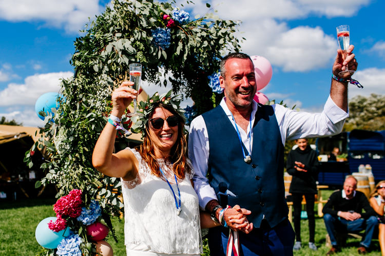 Flower Arch Backdrop Flowers Balloons Bright Fun Festival Boho Wedding The Party Field East Sussex http://epiclovestory.co.uk/