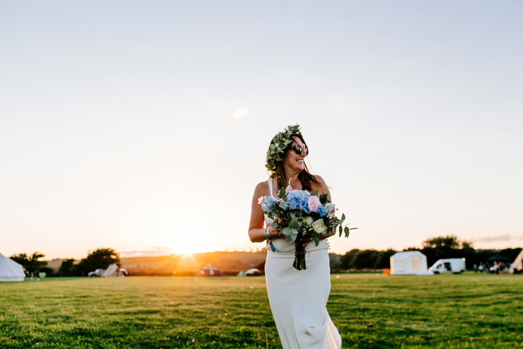 Bride Bridal Dress Gown Flowers Bouquet Crown Sunglasses Bright Fun Festival Boho Wedding The Party Field East Sussex http://epiclovestory.co.uk/