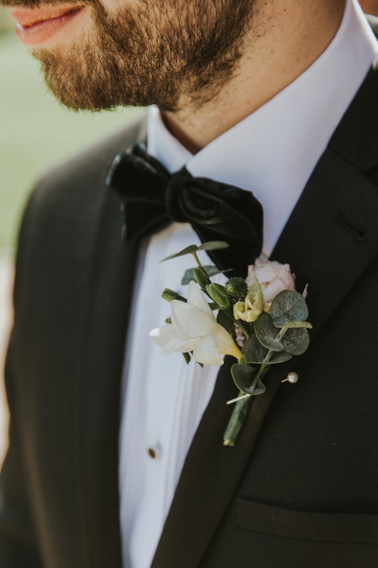 Buttonhole Black Suits Bow Ties Velvet Tuxedos Groom Alternative Vintage 1950s Knighton House Wedding Dorset http://www.paulunderhill.com/