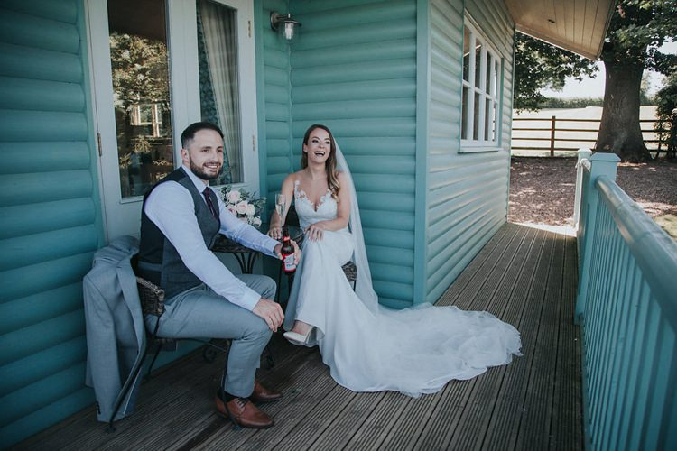 Bride Bridal Pronovias Sleeveless Dress Gown Veil Bouquet Eucalyptus Pink Rose Groom Grey Three Piece Suit Waistcoat Burgundy Tie Stylish Homemade Country Summer Marquee Wedding Millers of Netley Shropshire http://www.joboultonphotography.com/