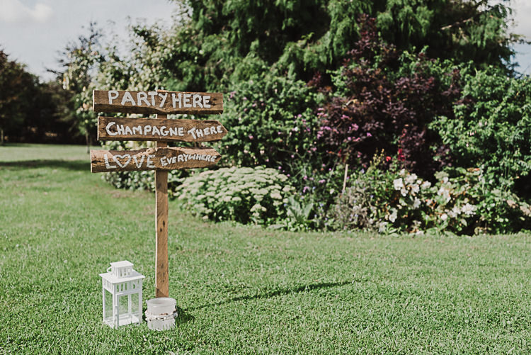 Rustic Wooden Signage Sign Post Lantern Magical Marquee Summer Alveston Pastures Farm Wedding https://willpatrickweddings.com/