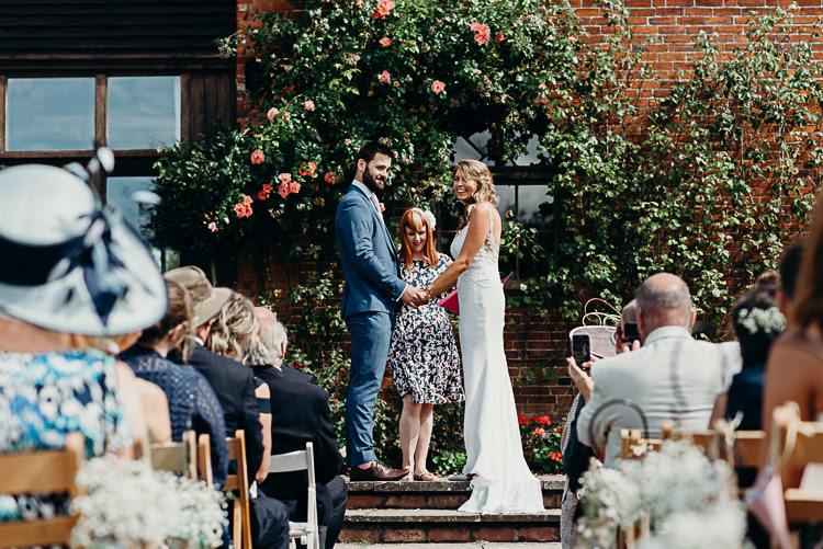 Bride Bridal Sleeveless Dress V Neck Blue Suit Groom Ceremony Outdoor Patio Magical Marquee Summer Alveston Pastures Farm Wedding https://willpatrickweddings.com/