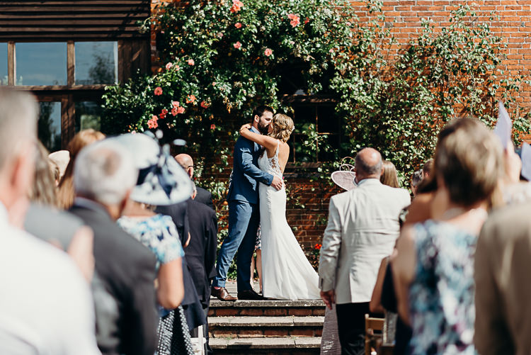 Bride Bridal Sleeveless Backless Dress V Neck Blue Suit Groom Pink Tie Magical Marquee Summer Alveston Pastures Farm Wedding https://willpatrickweddings.com/