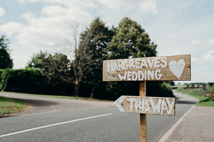 Rustic Wooden Signage Sign Post Magical Marquee Summer Alveston Pastures Farm Wedding https://willpatrickweddings.com/