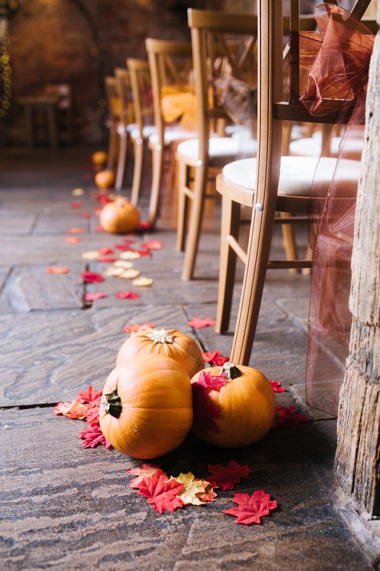 Pumpkins Confetti Aisle Ceremony Autumn Packington Moor Wedding Staffordshire Farm Barn Burgundy http://kathrynedwardsphotography.com/