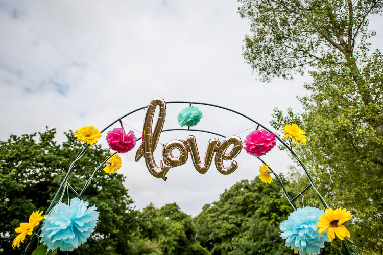 Arch Love Balloon Pom Pom Mismatched Colourful Wildflower Meadow Wedding Hush Venues Norfolk http://lighteningphotography.co.uk/