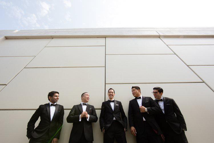 Groom Groomsmen Group Photo Bridge Hangar Building | Black Tie Carnival Wedding Hot Air Balloon http://www.makingthemoment.com/
