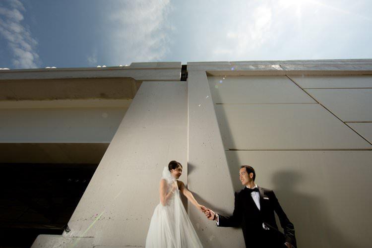 Bride Groom Photo Bridge Hangar White Building | Black Tie Carnival Wedding Hot Air Balloon http://www.makingthemoment.com/