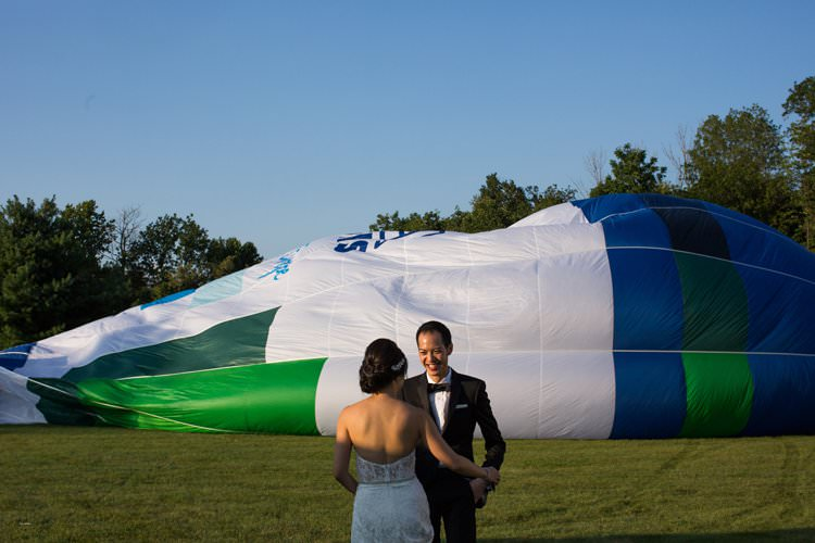 Outdoor Summer Field Rustic Marquee Tipi Tent Bride Groom | Black Tie Carnival Wedding Hot Air Balloon http://www.makingthemoment.com/