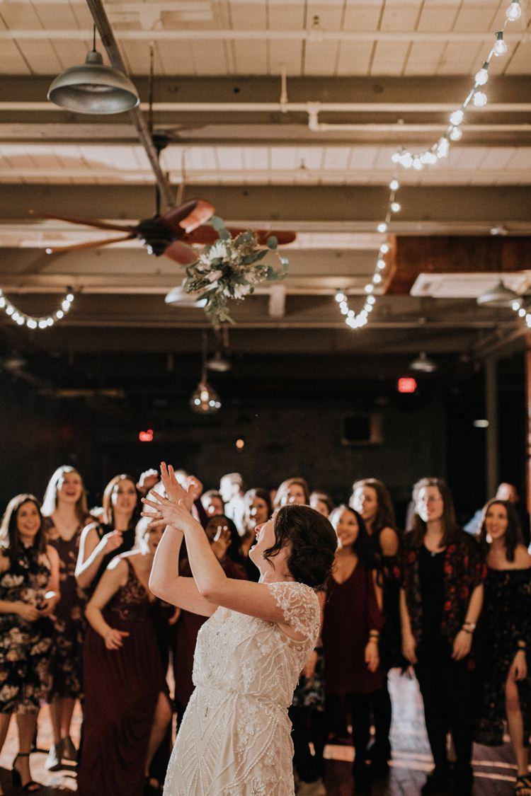 City Urban Georgia Engine Room Exposed Bricks Reception Dinner Chiavari Chairs Rustic Bouquet Toss | Bohemian Industrial Oxblood Wedding https://www.lunaleephotos.com/