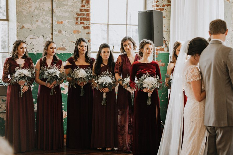City Urban Georgia Engine Room Exposed Bricks Ceremony Aisle Bride Greenery White Bouquet Burgundy Bridesmaids | Bohemian Industrial Oxblood Wedding https://www.lunaleephotos.com/