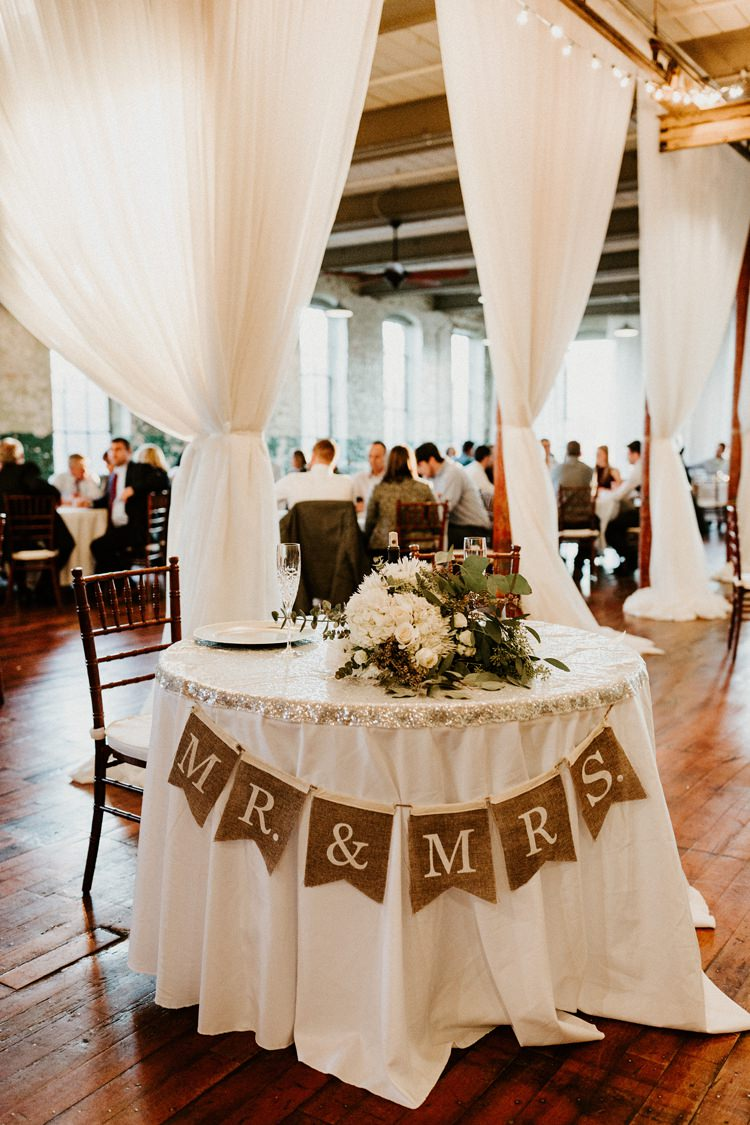 City Urban Georgia Engine Room Exposed Bricks Reception Dinner Chiavari Chairs Rustic Hessian Bunting | Bohemian Industrial Oxblood Wedding https://www.lunaleephotos.com/