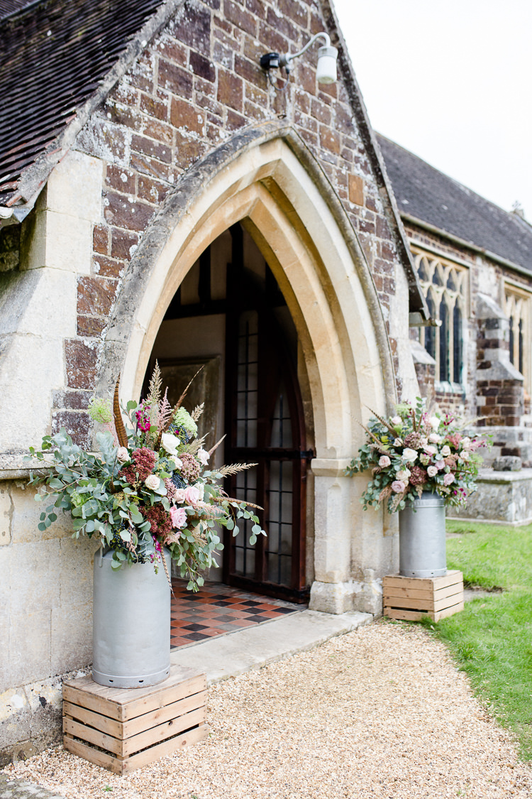Church Entrance Milk Churns Floral Flowers Pheasant Feathers Autumn Countryside Family Farm Wedding Dorset http://www.lydiastampsphotography.com/