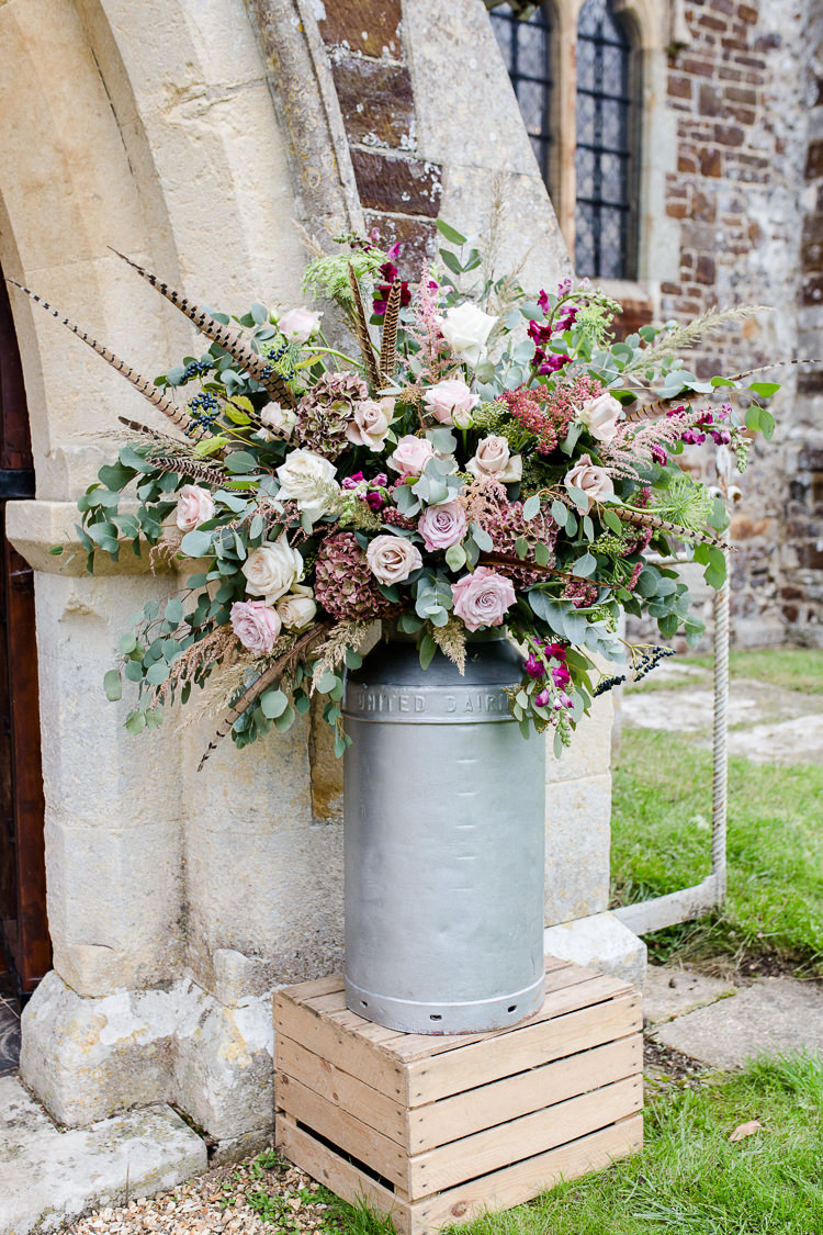 Church Entrance Milk Churn Florals Flowers Pallet Pheasant Flowers Rose Autumn Countryside Family Farm Wedding Dorset http://www.lydiastampsphotography.com/