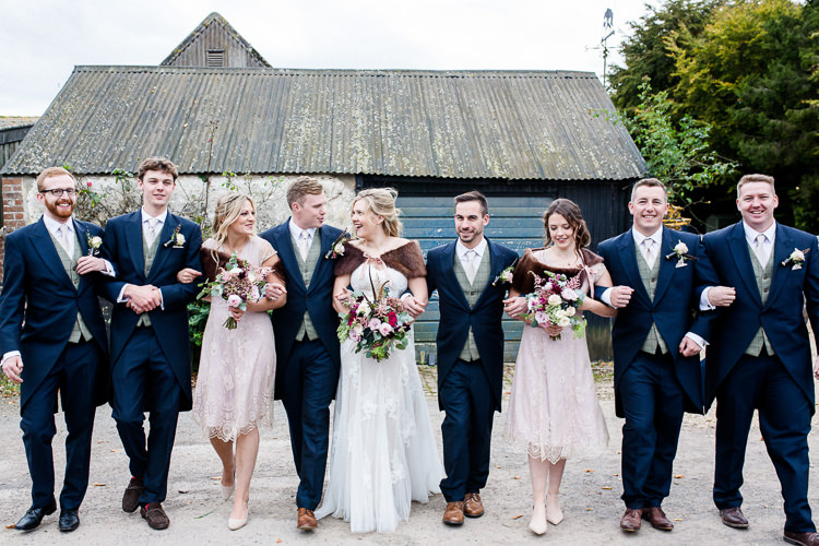 Bride Bridal Lace Strapless Dress Tulle Veil Bouquet Multicoloured Pheasant Feather Groom Blue Tails Waistcoat Three Piece Suit Bridesmaids Pink Blush Brown Fur Cape Groomsmen Autumn Countryside Family Farm Wedding Dorset http://www.lydiastampsphotography.com/