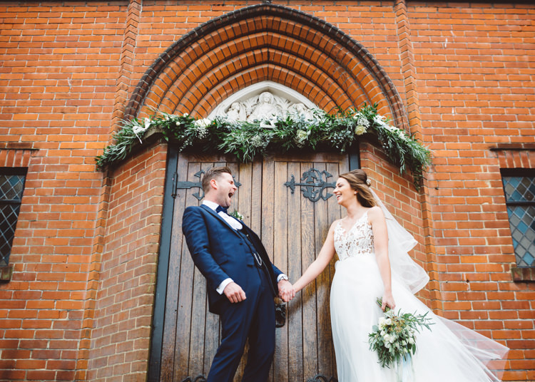 Bride Bridal Hayley Paige Dress Gown Tulle Princess Tuxedo Groom Waistcoat Navy Bow Tie Bouquet Ribbon Church Doorway Greenery Runner Cool Stylish Windy Coastal Wedding East Quay Lobster Shack Whitstable http://holliecarlinphotography.com