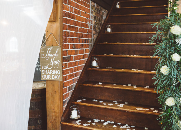 Stairway Confetti Candles in Jars Greenery Foliage White Cream Roses Cool Stylish Windy Coastal Wedding East Quay Lobster Shack Whitstable http://holliecarlinphotography.com/