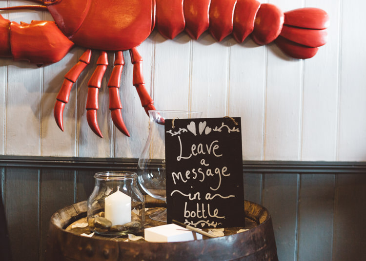 Guest Book Message in a Bottle Barrel Candle in Jar Cool Stylish Windy Coastal Wedding East Quay Lobster Shack Whitstable http://holliecarlinphotography.com/