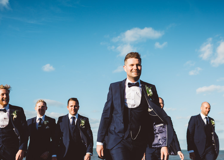 Navy Blue Tuxedo Groom Waistcoat Bow Tie Cool Stylish Windy Coastal Wedding East Quay Lobster Shack Whitstable http://holliecarlinphotography.com/