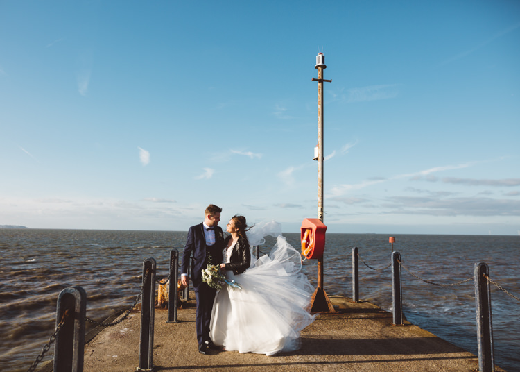 Bride Bridal Hayley Paige Dress Gown Tulle Princess Tuxedo Groom Waistcoat Navy Bow Tie Bouquet Ribbon Leather Jacket Cool Stylish Windy Coastal Wedding East Quay Lobster Shack Whitstable http://holliecarlinphotography.com/